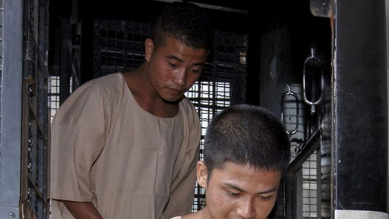 Burmese migrant workers Zaw Lin and Win Zaw Htun arrive at the Koh Samui Provincial Court, in Koh Samui
