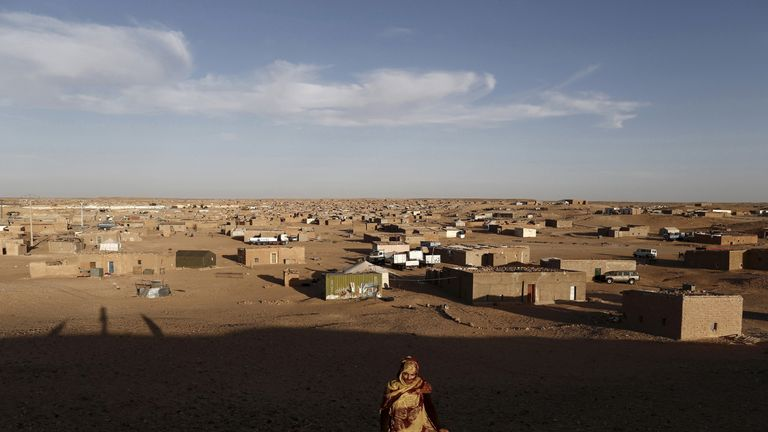 An indigenous Sahrawi woman walks at a refugee camp of Boudjdour in Tindouf, southern Algeria