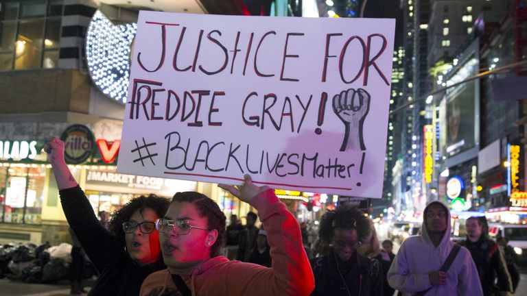Demonstrators march in Baltimore in the Black Lives Matter campaign