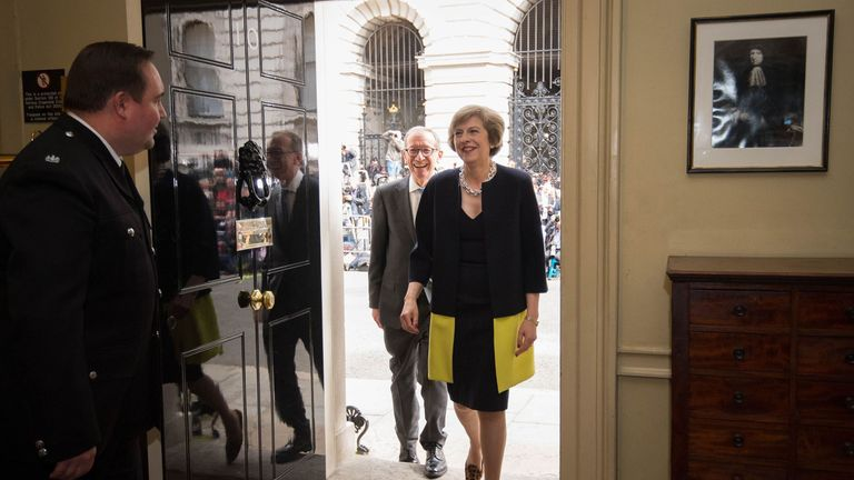 Prime Minister Theresa May and husband Philip enter 10 Downing Street