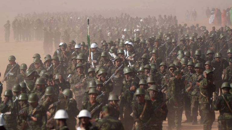 Members of the Sahrawi People's Liberation Army parade during a ceremony to mark 40 years after the Front proclaimed the Sahrawi Arab Democratic Republic (SADR) in the disputed territory of Western Sahara
