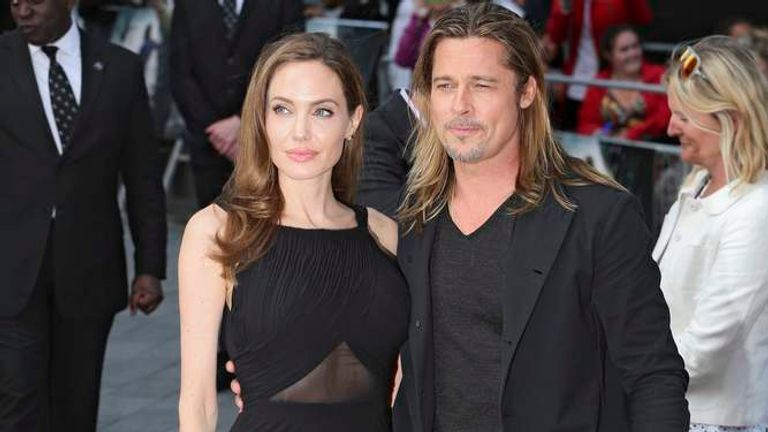Angelina Jolie poses with her husband Brad Pitt as they arrive for the world premiere of his film World War Z in London