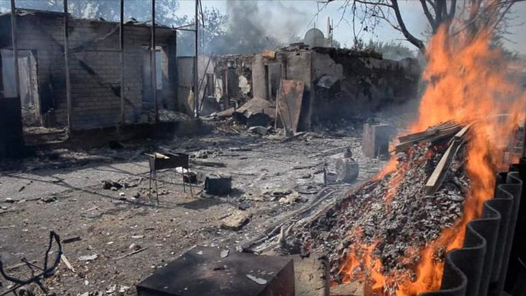 Buildings burning after attacks during the ceasefire in east Ukraine