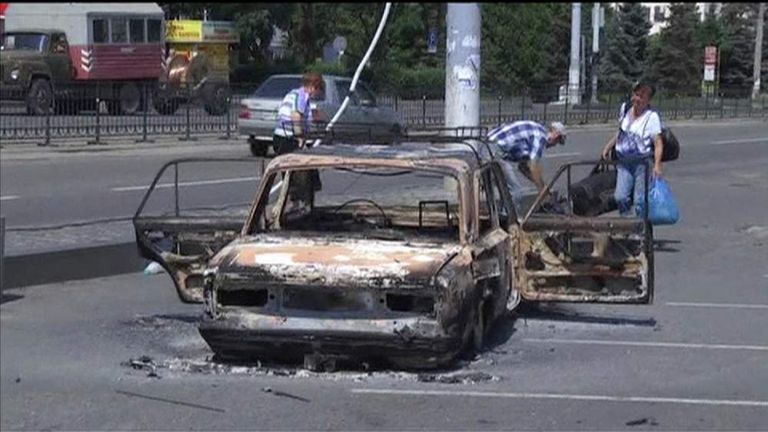 A burnt-out car in Ukraine after missiles were fired in clashes between Ukrainian forces and pro-Kremlin rebels