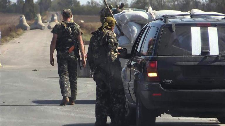Ukrainian soldiers man the frontline near Mariupol