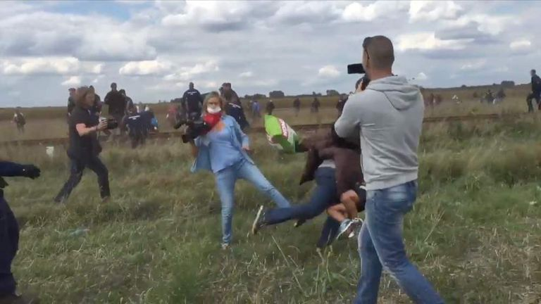 Hungarian camerawoman appears to trip up fleeing refugee with child