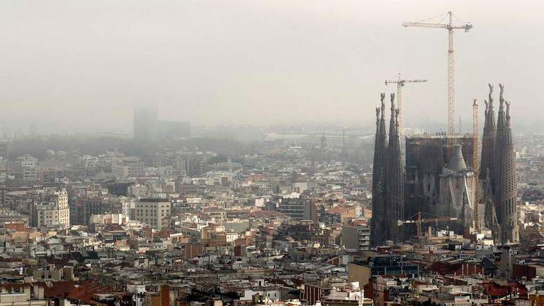 The Basilica Sagrada Familia is seen as fog gradually recedes in Barcelona