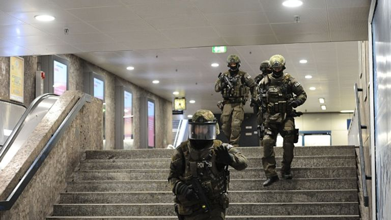 Police walk inside a subway station