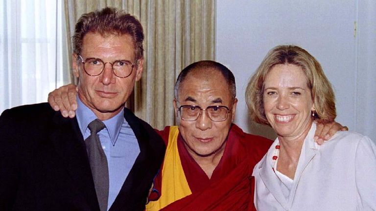 The Dalai Lama of Tibet poses with actor Harrison Ford (L) and his wife Melissa Mathison Ford during..