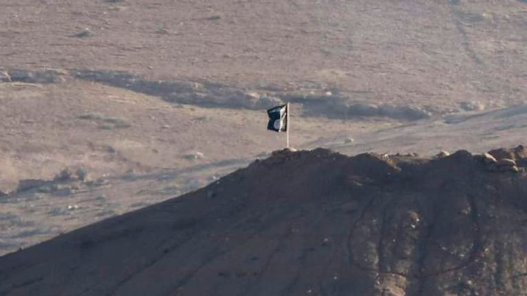 Black flag belonging to the Islamic State is seen near the Syrian town of Kobani, as pictured from the Turkish-Syrian border near the southeastern town of Suruc in Sanliurfa province