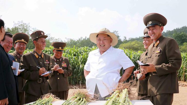 North Korean leader Kim gives field guidance to Farm No. 1116 under the KPA Unit 810 in this undated photo released by North Korea's KCNA in Pyongyang