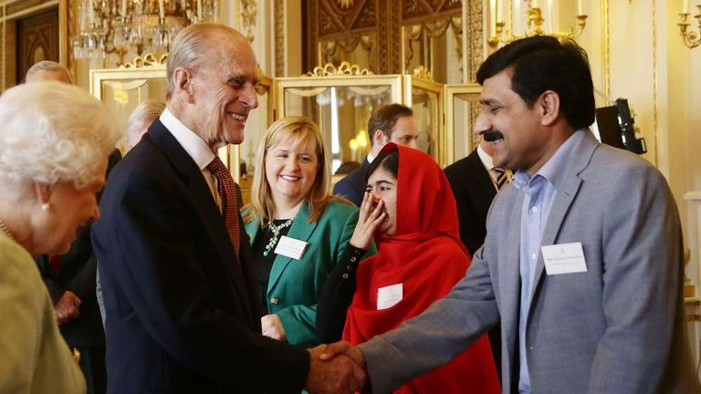 Malala is reduced to giggles at the Duke's joke