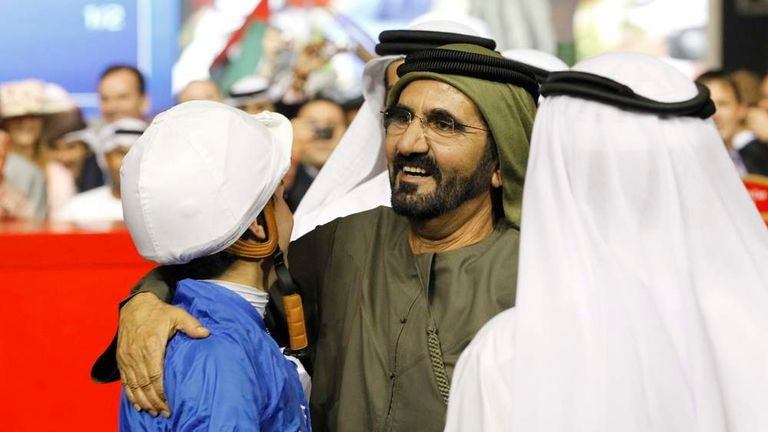 Mickael Barzalona, riding Monterosso, celebrates with Dubai ruler and Vice-President and Prime Minister of the UAE Sheikh Mohammed bin Rashid Al Maktoum after winning the ninth and final race of the 17th Dubai World Cup at the Meydan racecourse