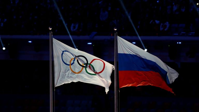File photo dated 23-02-2014 of The Olympic flag flies next to the Russian flag