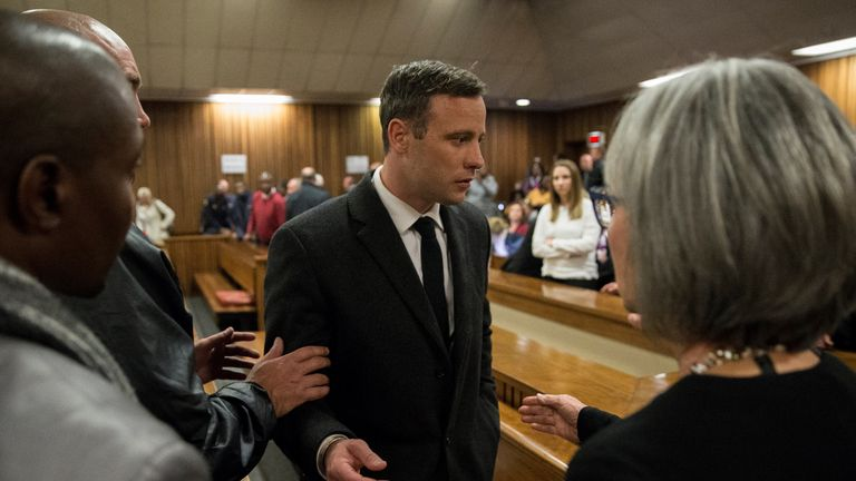 PRETORIA, SOUTH AFRICA - JULY 6:  Olympic athlete Oscar Pistorius speaks with relatives after sentencing at the High Court on July 6, 2016 at the High Cour