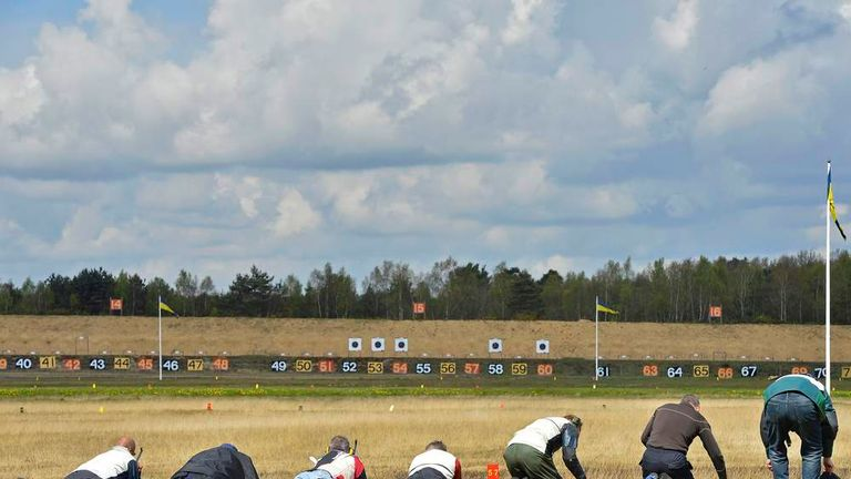 Competitors shoot on a target range at Bisley in south east England