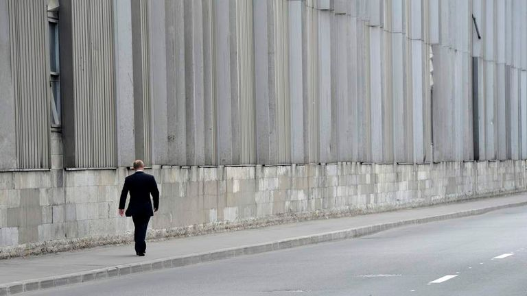 Russian President Putin walks after leaving a memorial service to his former judo trainer Rakhlin in St.Petersburg