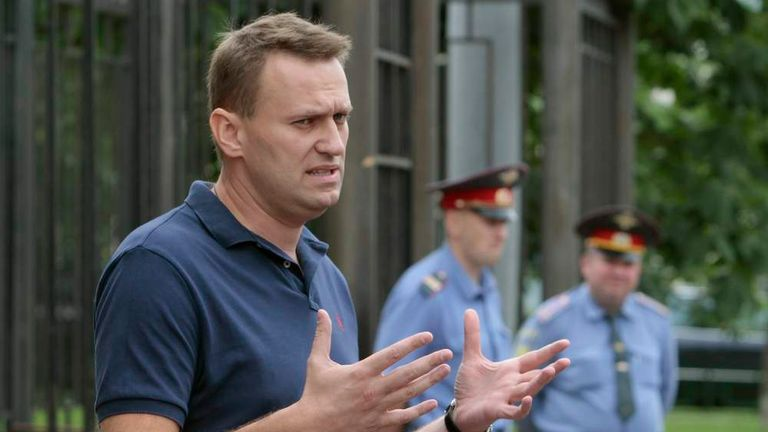 Russian anti-corruption blogger Alexey Navalny speaks to the media after questioning at the Federal Investigation Commission building in Moscow June 13, 2012.
