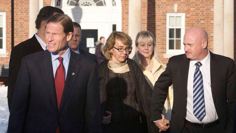 U.S. Senator Blumenthal, former U.S. Representative Giffords and her husband, former astronaut Kelly, leave the Newtown Municipal Building in Newtown,