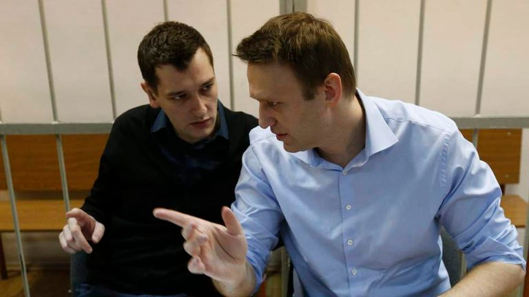 Russian opposition leader and anti-corruption blogger Alexei Navalny talks to his brother and co-defendant Oleg before a court hearing in Moscow