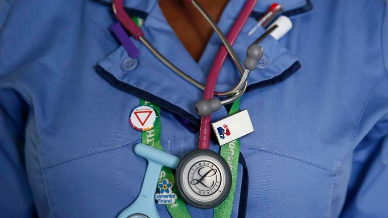 A nurse wears a watch and stethoscope at St Thomas' Hospital in central London