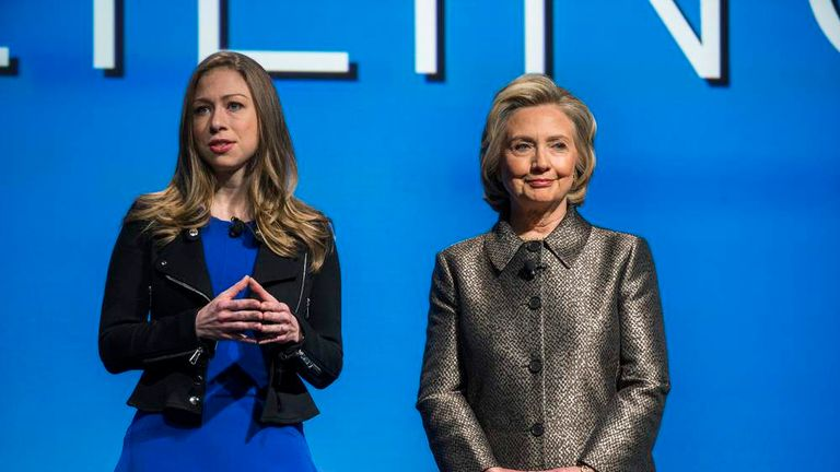 """Former U.S. Secretary of State Clinton listens to her daughter Chelsea speak during the unveiling of """"No Ceilings"""" and the """"Not There Yet: A Data Driven Analysis of Gender Equality"""" study in New York"""