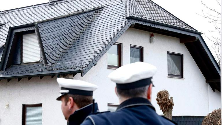 German policemen stand outside a house believed to belong to crashed Germanwings flight 4U 9524 co-pilot Lubitz in Montabaur