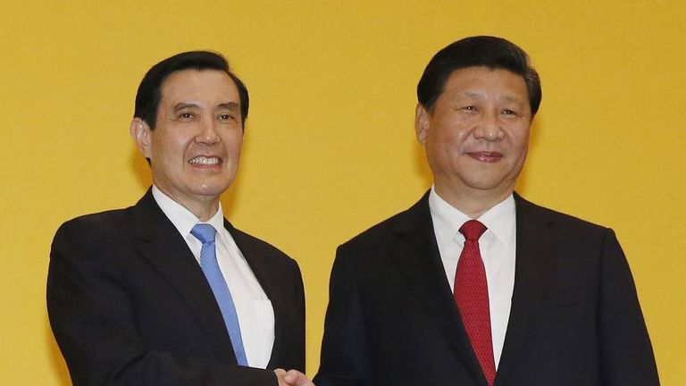 China's President Xi Jinping shakes hands with Taiwan's President Ma Ying?-jeou during a summit in Singapore