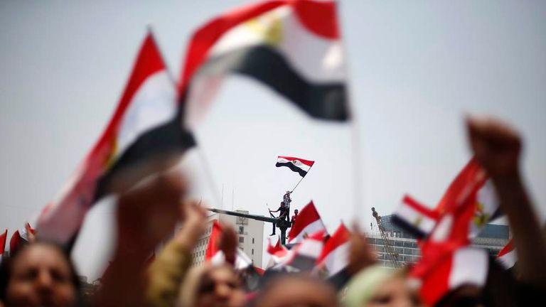 Protesters, who are against Egyptian President Mohamed Mursi, wave flags in Tahrir Square in Cairo