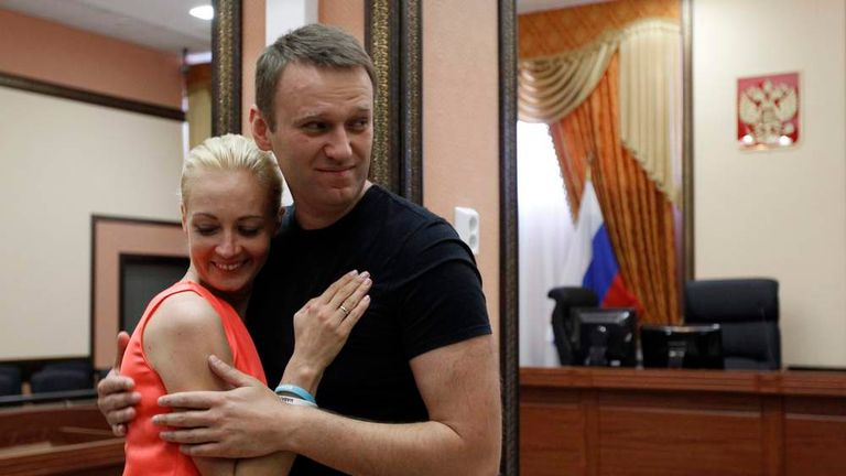 Russian opposition leader Alexei Navalny embraces his wife Yulia inside a court building in Kirov