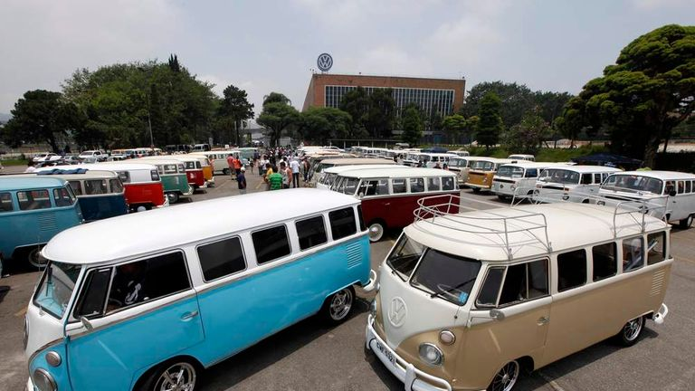 Various models of Volkswagen's Kombi minibus are displayed during a Kombi fan club meeting in Sao Bernardo do Campo