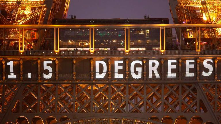 """The slogan """"1.5 Degrees"""" is projected on the Eiffel Tower as part of the World Climate Change Conference 2015 (COP21) in Paris"""