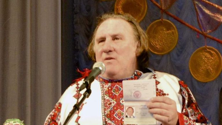 French actor Gerard Depardieu poses with his new Russian passport