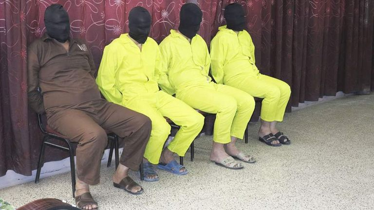 Detainees suspected of being part of an armed cell with links to al Qaeda are shown to the media during a news conference at the Defence Ministry in Baghdad
