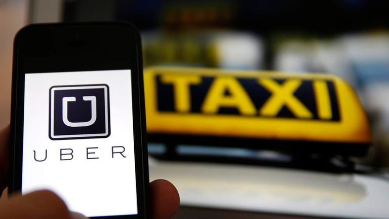 An illustration picture shows the logo of car-sharing service app Uber