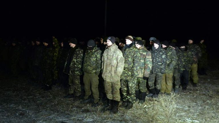 Ukrainian prisoners wait to be exchanged for rebel troops