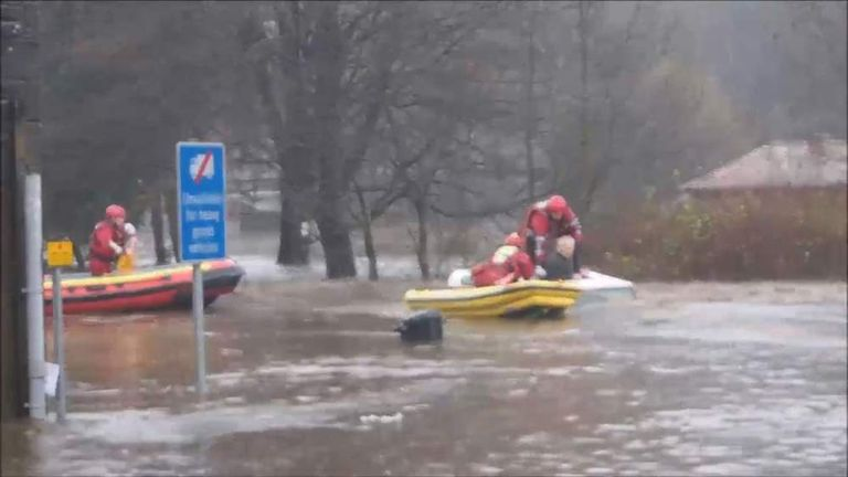 A man in his 70s had to be rescued from a submerged Land Rover in Mytholmroyd.