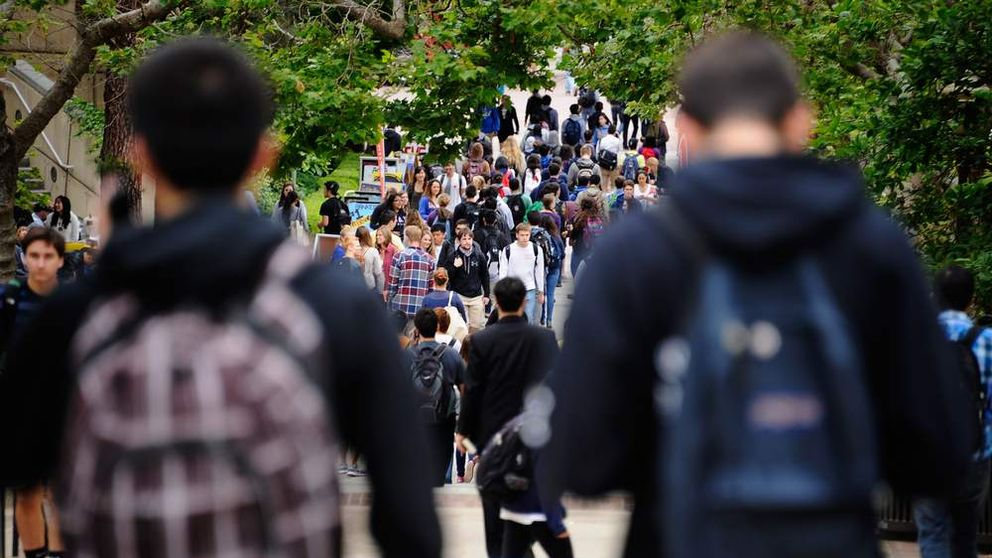 Students walk across the campus of UCLA
