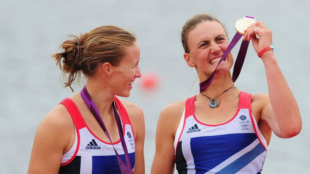 Helen Glover and Heather Stanning of Great Britain celebrate with their gold medals during the medal ceremony after the Women's Pair Final A on Day 5 of the London 2012 Olympic Games