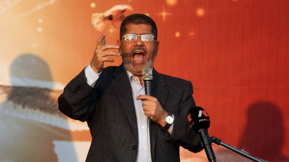 Egypt's Islamist President Mohamed Morsi addresses his supporters in front of the presidential palace in Cairo