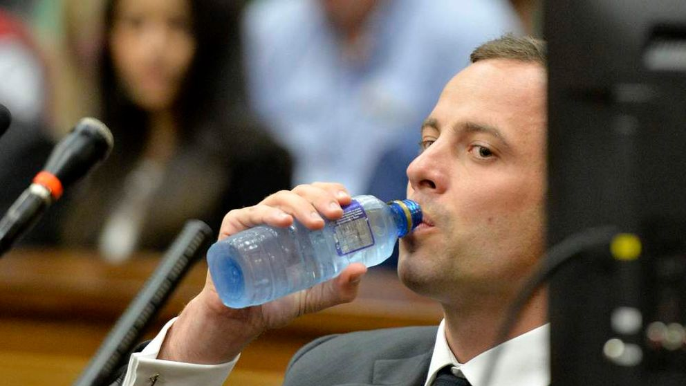 Pistorius drinks water in court ahead of his trial at the North Gauteng High Court in Pretoria