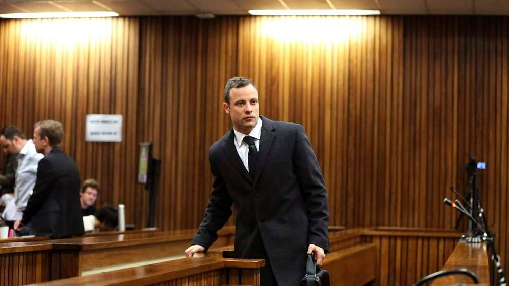 Olympic and Paralympic track star Pistorius enters the dock ahead of his trial for the murder of his girlfriend Reeva Steenkamp, at the North Gauteng High Court in Pretoria