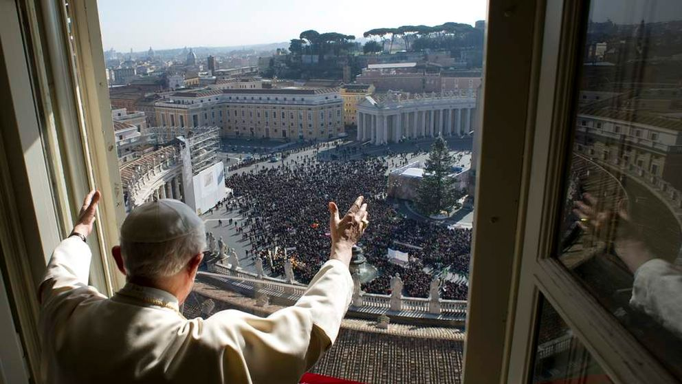 Pope Benedict XVI waves as he leads the Angelus prayer in Saint Peter's square at the Vatican in this picture provided by Osservatore Romano