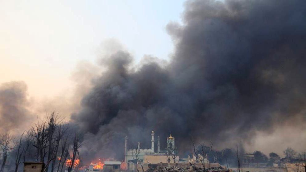 A mosque burns during a riot in Meikhtila