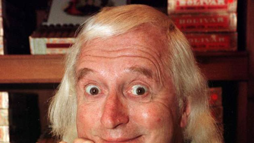 JIMMY SAVILE AT DUNHILL'S  OF JERMYN STREET