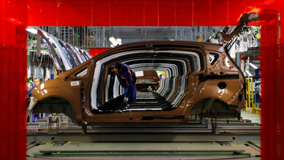 A worker checks vehicles at a Ford car plant in Craiova