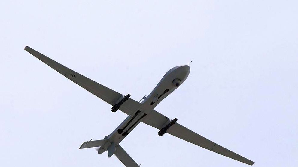 A US Air Force MQ-1 Predator, unmanned aerial vehicle, armed with AGM-114 Hellfire missiles