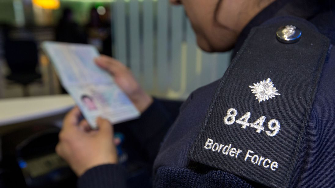 A UK Border Force officer checking passports. File picture