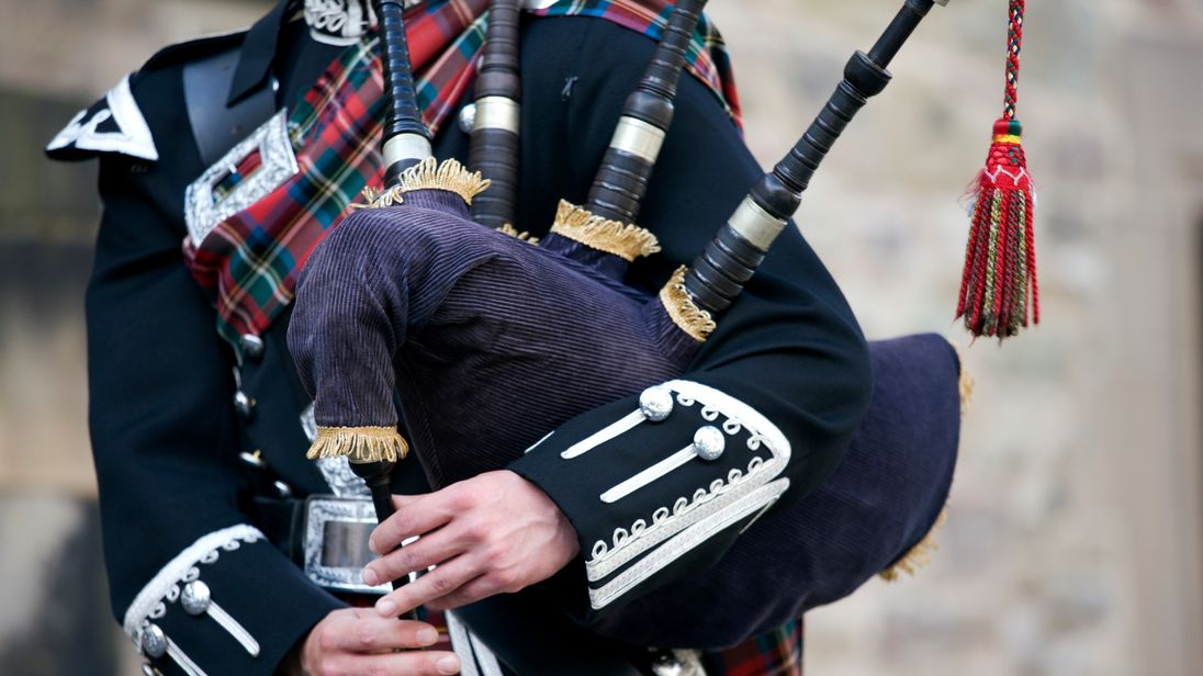 A bagpipe player