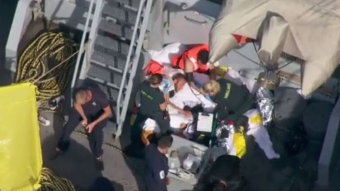 Footage from the Sky News helicopter shows two of the suspected migrants being treated by paramedics